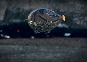 Falling glass piggy bank
